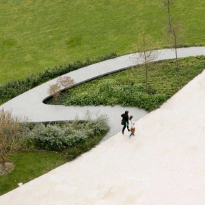 "Three public park ""pockets"" hooked onto the side of the central path display playful seating of recycled rubber. Each pocket has a different character: a reflecting puddles-seating amphitheater section, an ottoman seating section, and a ""garden"" section with ..."