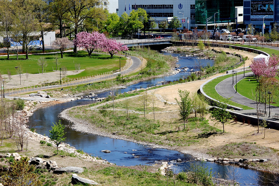 "OLIN led a team of ecologists and civil engineers, collaborating with experts to create a comprehensive and ambitious framework for a park and greenway. The end result: a dynamic park that is viable, active and alluring, a continuous programmed edge along the banks of Mill River, and a ""green zipper"" that brings together neighboring communities with downtown Stamford."