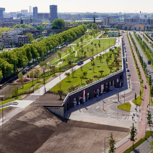The Rotterdam Roof park is developed in the so called 'Four Harbours' Strip: an elongated strip of no-man's land not far from the city centre of Rotterdam. The assignment is to integrate the development of 85.000m2 of offices, shops and schools with a sea dyke and a public park on top. This project works as a catalyst in the urban transformation of the harbours, and will form a new landmark along the 'Park lane' which is one of the most important roads of Rotterdam.