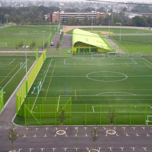 Heerenschürli serves as a hybrid sports complex and public park, giving the neighborhood facilities for organized sports as well as general leisure activities. A public square with seating and a restaurant are integrated into the complex; the lawns themselves are also public - openly accessible during the off-hours of the local athletic clubs.