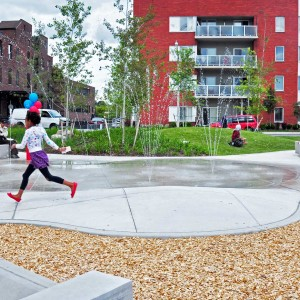 The park design references the history and geography of the area and the Don River, and provides critical open green space for the growing and vibrant Rivertowne community. River plantings and sinuous benches frame old and new park elements. A central gathering space connects other park elements including community garden plots, a multi-function sport court, a bosque of trees and large grassy berms.